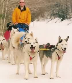 Seven leading a sleddog team with her dad, Vader